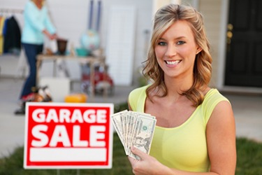 Natalie considered her garage sale a success because she made over one hundred dollars.