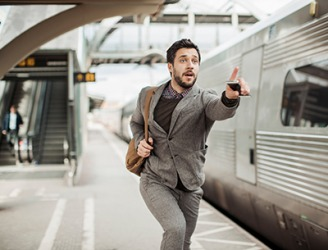 Jonathan knew it was futile to catch the train once it started moving but he continued to run after it anyway.