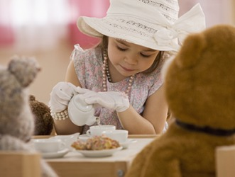 Scarlett likes to dress up fancily and have whimsical tea parties with her bear family.