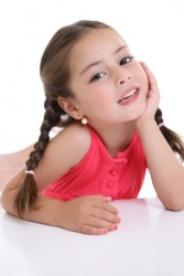 A little girl with her hair in braids.