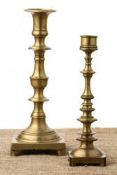A pair of brass candlesticks.