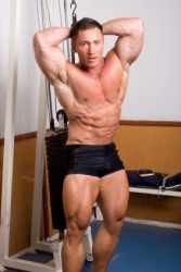 A brawny bodybuilder exercising.
