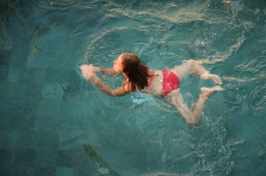 A young woman doing the breast stroke.