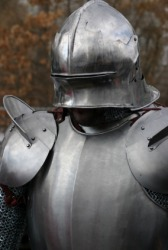 A suit of armor with close up on the breastplate.