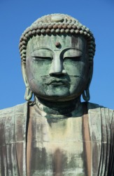 A large statue of Buddha, the founder of Buddhism.