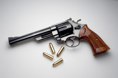 A revolver and the bullets it uses.