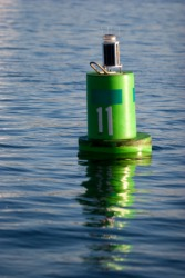 A channel marking buoy floating in a bay.