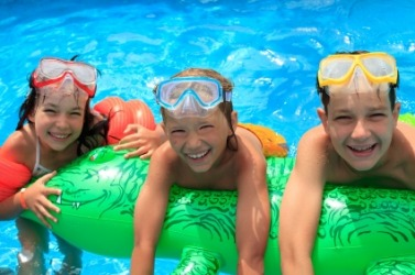 Children enjoying the buoyancy of their inflatable water toy.