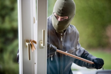 A man commiting a burglary.