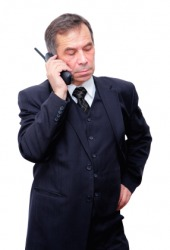 A businessman on the telephone.