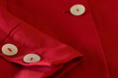 A red shirt with white buttons.