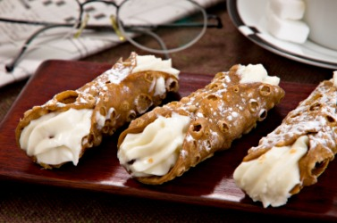 Three sweet Italian cannolis.