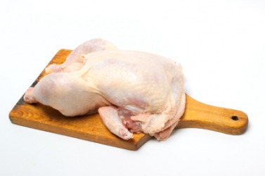 The carcass of a chicken ready to be cooked.