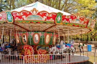 A carousel in a park.