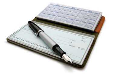 A pad of checks in a checkbook.