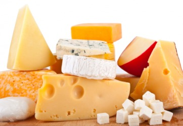 A stack of various types of cheese.
