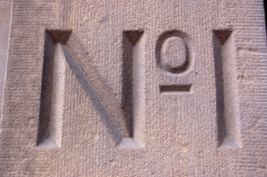 Letters chiseled into a piece of stone.