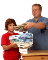 A father and son doing chores.