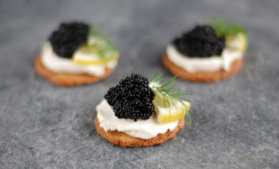 Toast and cream cheese topped with caviar.