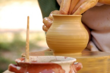 A piece of pottery being formed out of clay.