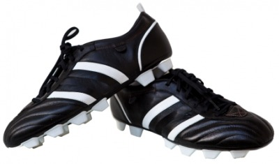 A pair of shoes with cleats.