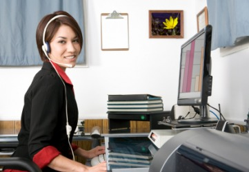 An Office Clerk Working At Her Desk