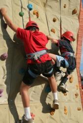 Climbers on an artificial rock wall.