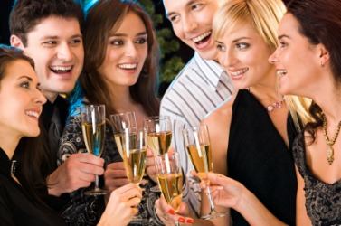 A group of people celebrating an occasion with glasses of champagne.