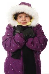 A little girl snuggling in her warm winter coat.