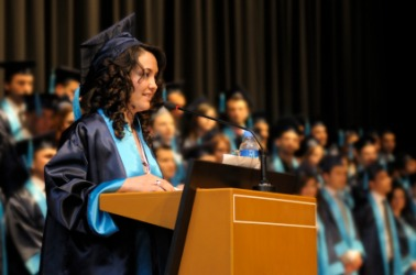 A graduate speaking at her commencement ceremony.