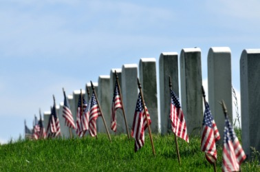 Flags adorn soldiers graves on Memorial Day also called Decoration Day.