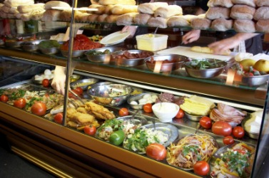 Food displayed in a delicatessen or deli.