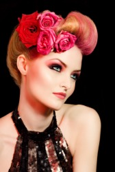 A womans coiffure decorated with flowers.