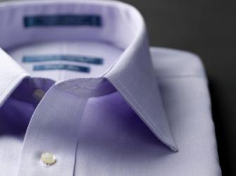 The collar of a mans shirt.