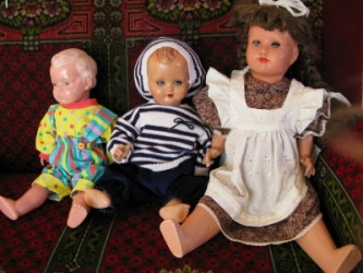 Three antique dolls.