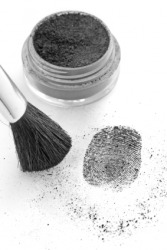 A specific dusting powder is being used to detect fingerprints.