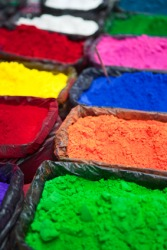 Colorful dyes in powder form.