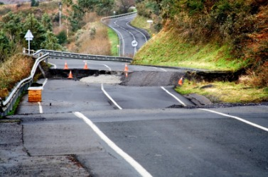 A road broken by an earthquake.