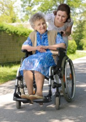 An elderly woman in a wheelchair.