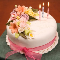 A cake embellished with flowers.
