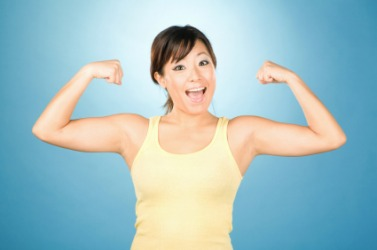 A young woman with her arms flexed.