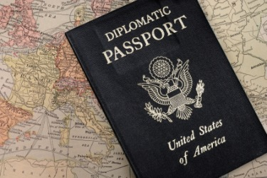A diplomat is a governments official envoy.