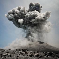 A volcano erupts.