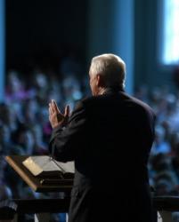 An evangelist speaks to his congregation.