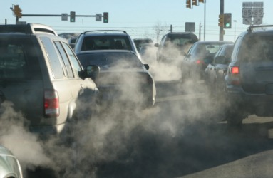 Exhaust fumes from numerous automobiles.
