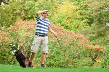 A man conducts an exhaustive search for his golf ball.
