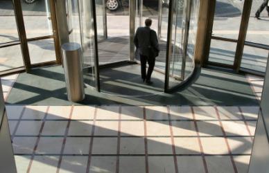 A man exits a building.