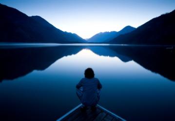 A calm lake at sunset.