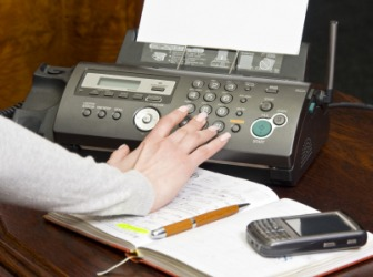 A person using a fax.