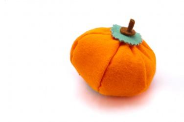 A pumpkin made from felt.